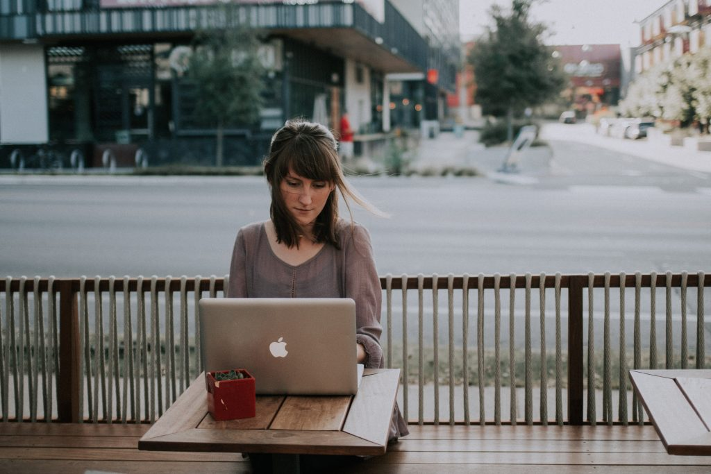 French Recruitment Agency, girl working outdoor on notebook